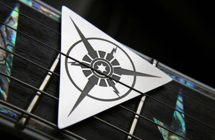 Image of Tantris Nova model etched steel guitar pick