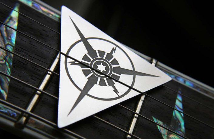 Image of Tantris Nova model etched steel guitar pick